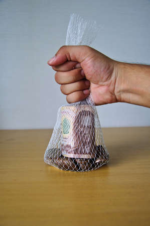 concept of save money , Thai money in bag photo