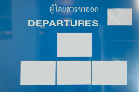 Departure sign at an airport photo