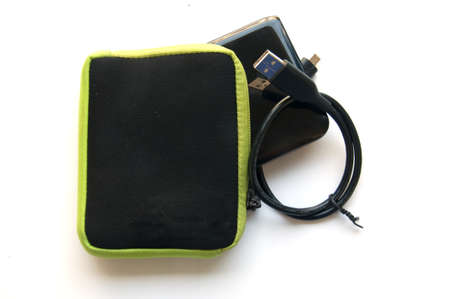external hard disk drive: Portable external hard disk drive with USB cable Stock Photo