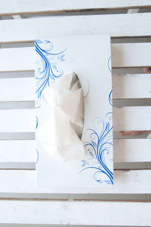 Tissue box on white wood photo