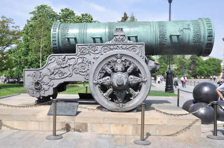 Historic cannon and balls in front of a church at the Kremlin. War and Peace united at the Kremlin. photo