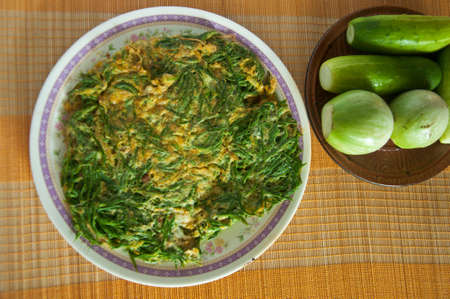 pennata: Fried Acacia Pennata with beaten egg (cha-om kai in Thai)