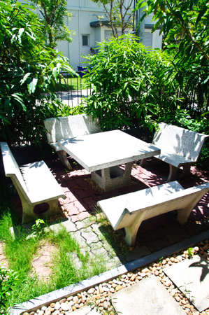 Stone Garden Table and four chairs. photo