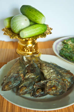 Fried Mackerel fish and fried vegetable photo