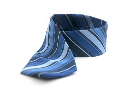 view of the details of a blue, striped necktie. photo