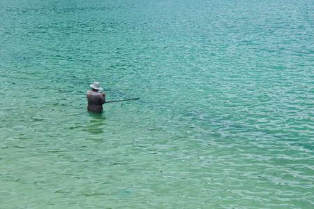 woman fishing at the sea