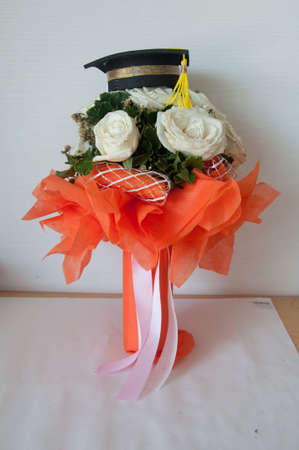 congratulation-round bouquet of white roses for graduate