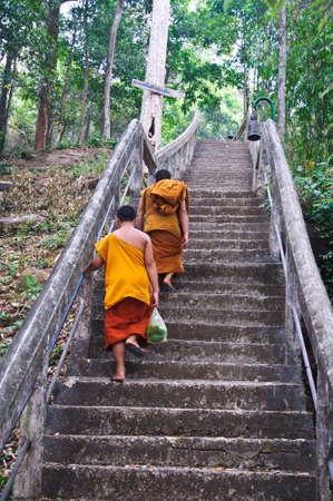eligion: Buddhist monk walking to temple