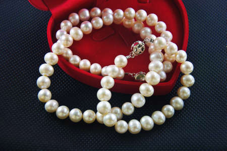 Pearl necklace against a black background photo