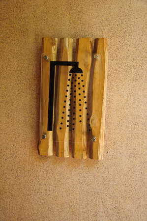 showering: shower sign in wood on cement wall