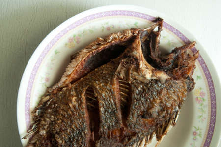 nilotica: crisp fried Tilapia fish on dish