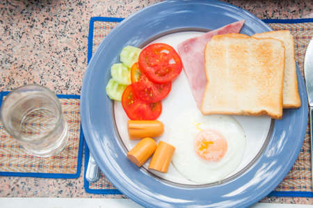 bacon and eggs: bacon, eggs, tomato and hotdog breakfast Stock Photo
