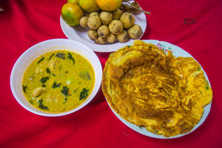 omlet: Delicious red curry with pork omelet and fruit. (Thai food in meal) Stock Photo