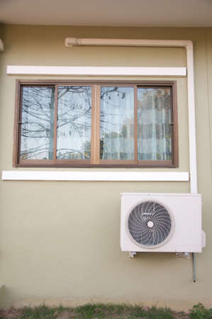 room air: The sliding glass window and air conditioner