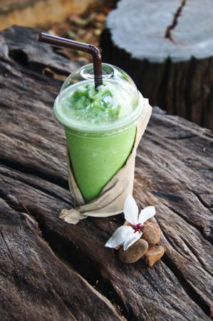 green tea frappe in nature background