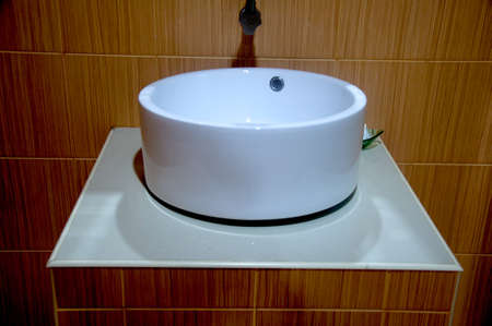 vessel sink: Closeup of round white sink in modern bathroom