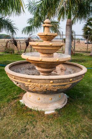 garden fountain: fountain in Thai garden Stock Photo