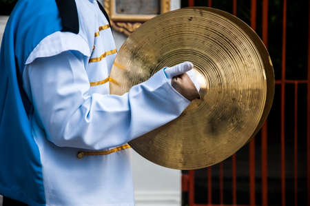 cymbals: Cymbals in hand- School Marching Band