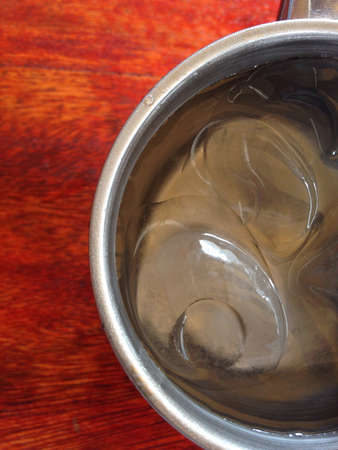 metal: Water and ice in metal cup