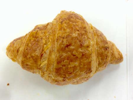 Fresh homemade french croissant on white