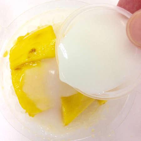 Thai mango sticky sweet rice dessert on white