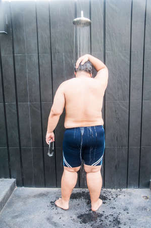 bathing man: Fat man take shower after pool swim