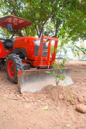 farm equipment: Tractor ploughing tree, farm equipment