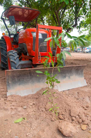 farm equipment: Tractor ploughing tree, farm equipment