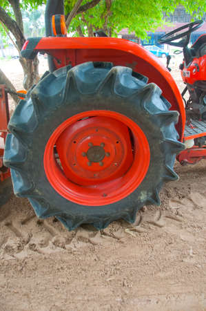 wheeled tractor: Wheeled tractor in the sand Stock Photo