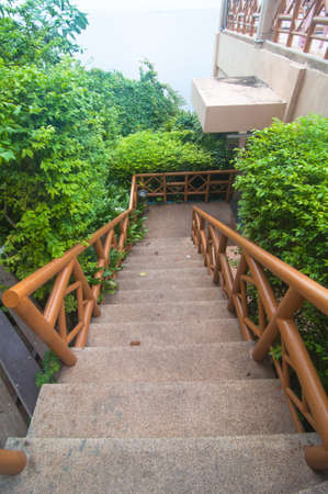 hand rails: Stone staircase with wood hand rails