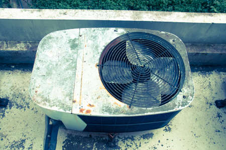 outside machines: Old rusty air conditioner outdoor