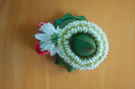Flower garlands of thai style on wood photo