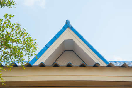 tile cladding: Tile roofing and shake gable details on modern home Stock Photo
