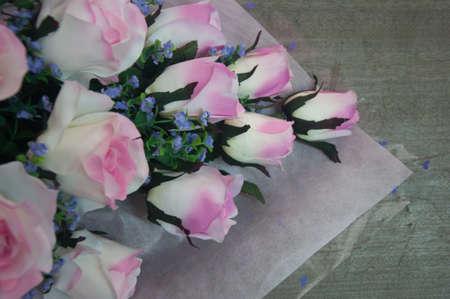 artificial flower: artificial flower bouquet against a wood wall background
