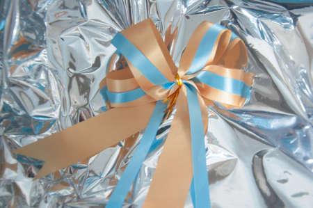 ribbon bow: ribbon bow on silver background Stock Photo