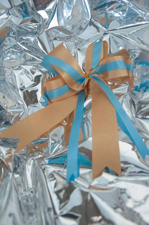 silver ribbon: ribbon bow on silver background Stock Photo