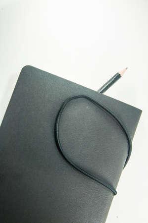 elastic band: Black copybook with elastic band bookmark Stock Photo