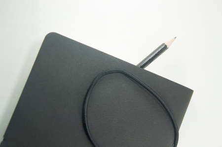 elastic band: Black copybook with elastic band bookmark and pencil