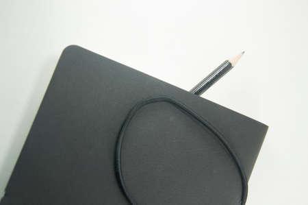 elastic band: Black copybook with elastic band bookmark and pencil