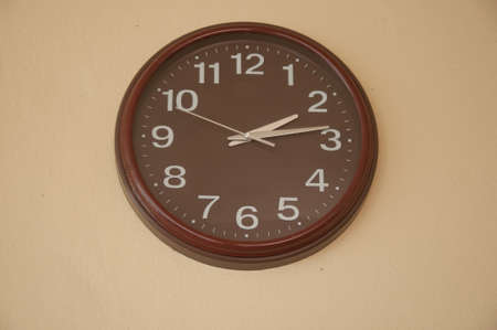 o'clock: Clock showing 2.14 oclock pm on wall