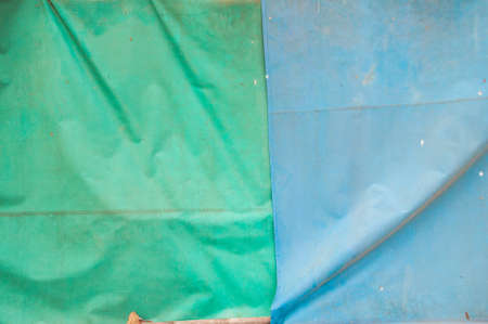 an awning: old green and blue awning background Stock Photo