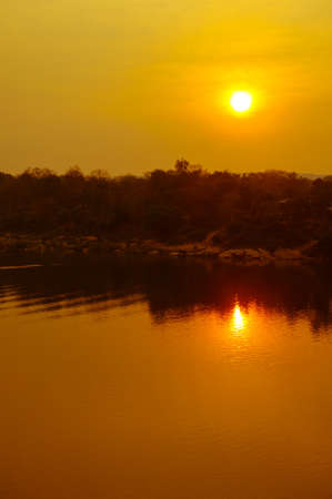 mekong river: Yellow sunset in the Mekong river Stock Photo