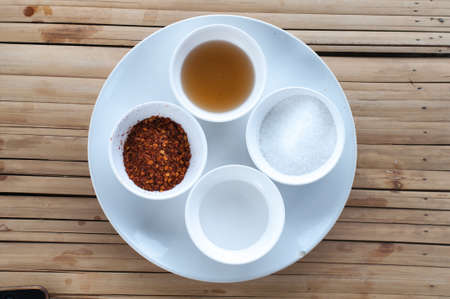 house ware: Thai seasoning container include cayenne pepper, sugar, fish sauce and chilies Stock Photo