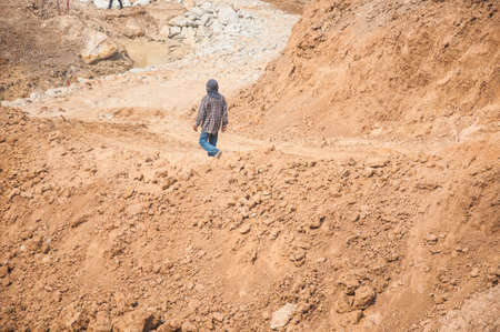 sand quarry: sand quarry : building site man working on ground Stock Photo