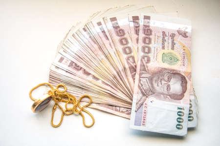 gold chain: Gold chain and Thai money Stock Photo