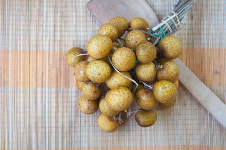 flesh colour: longan (dimocarpus longan) with a bunch of ripe longan