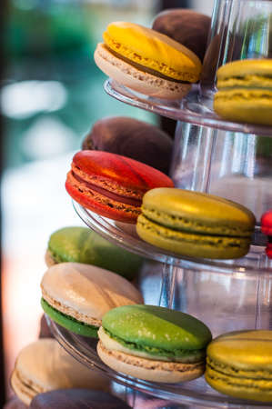 boulangerie: French macaroons on a cake stand . Candy bar on wedding