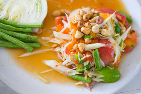 green papaya salad: Green papaya salad Thai cuisine spicy delicious - SOM TAM - Thai call Stock Photo