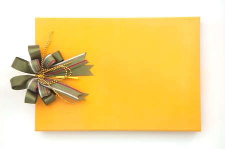 gift yellow box with green ribbon bow on white background