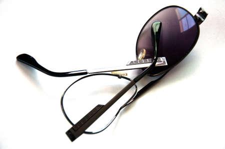 utilized: Shabby old sunglasses on white background Stock Photo